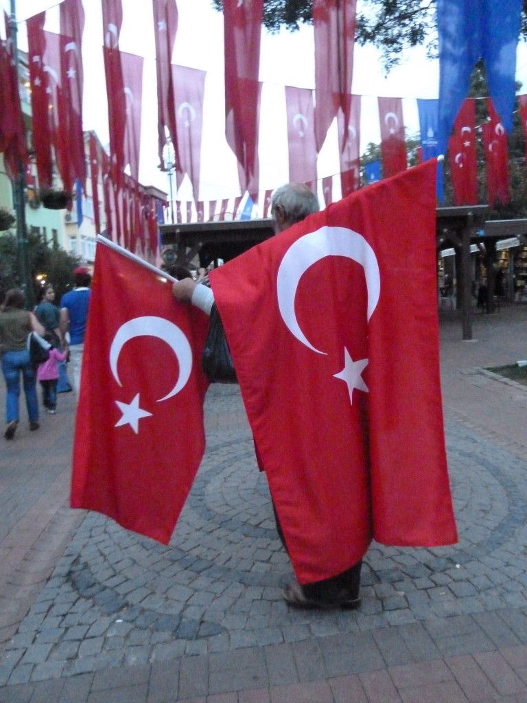 Man selling flags in Istanbul, Turkey