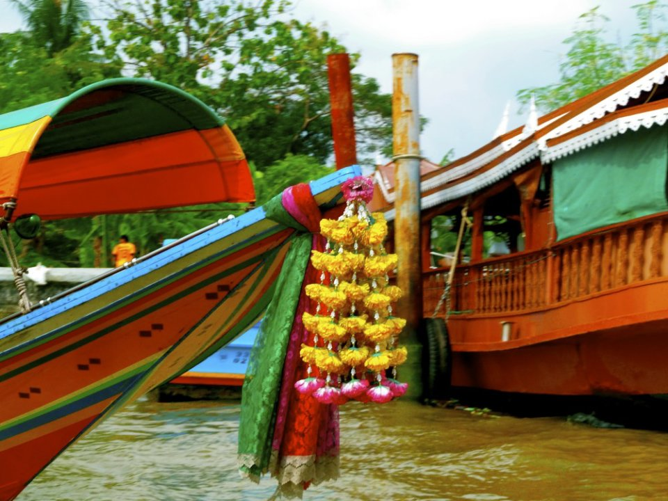 Long-tail boat along the banks of the Chao Phraya River, Bangkok, Thailand