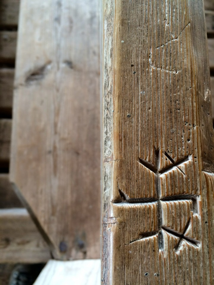 Carving in pew at the parsonage in Maakalla Island, Finland