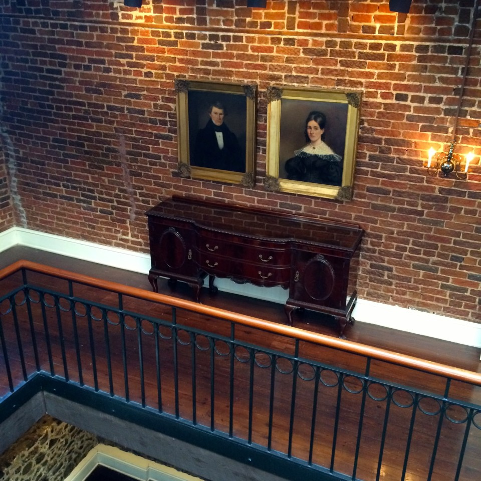 Photos on a brick wall in Savannah, Georgia, Things to do in Savannah GA