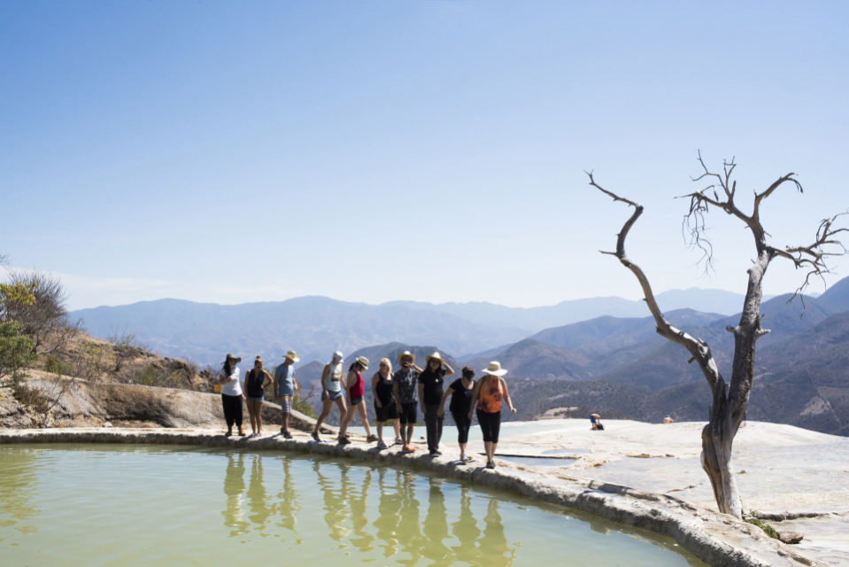 People walking along the petrified waterfall known as Hierve el Agua, Oaxaca, Mexico