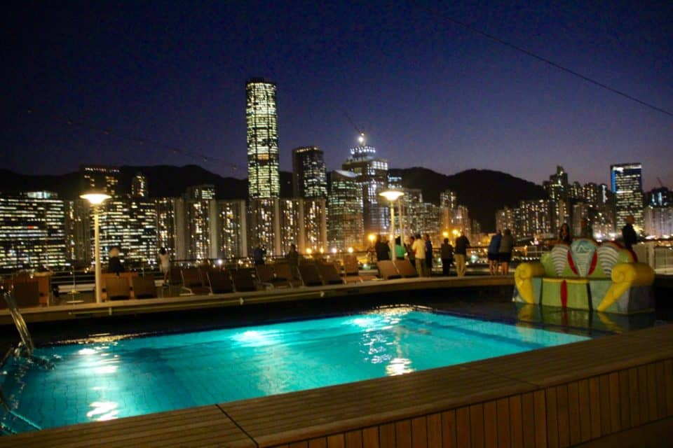 Come cruise Holland America on a global cruise, Hong Kong View from deck with swimming pool