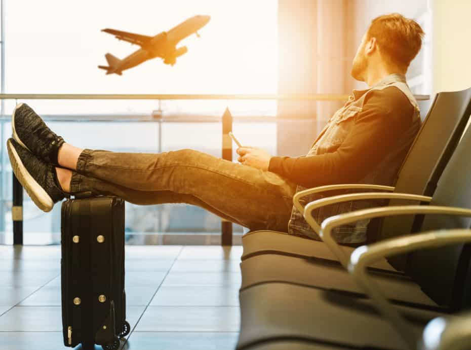 Man sitting at airport, Why do people travel, #Travel