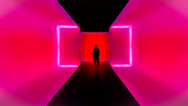 Person standing in pink Museum of the Fine Arts
