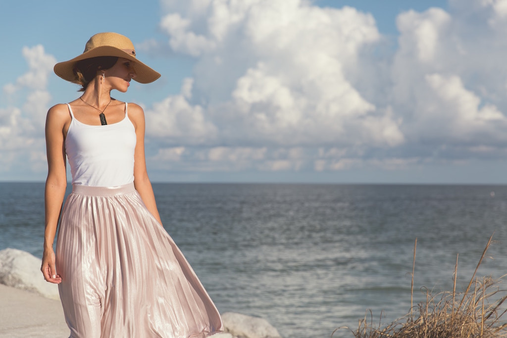 Bride in pink and white on the beach