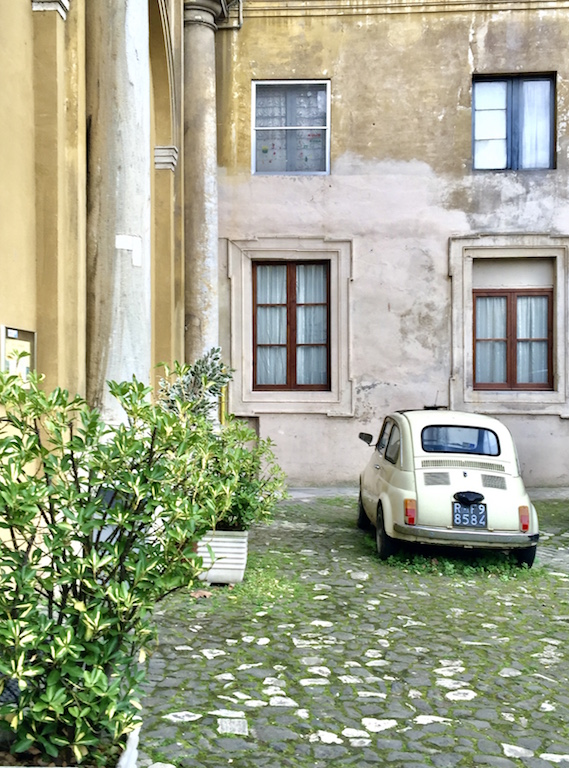 White car with Rome plates